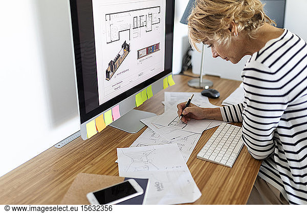 Female architect working on project in home office
