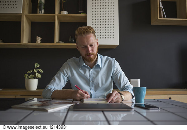 Freelance businessman working at home