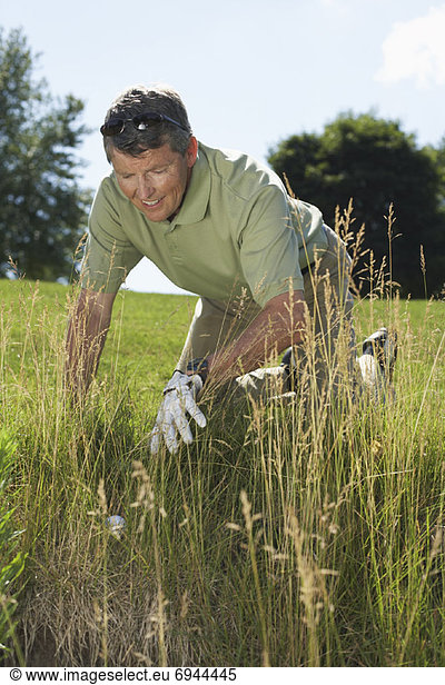 Golfer Searching for Lost Ball