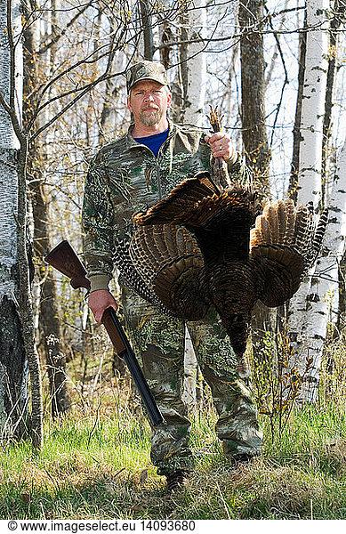 Hunter with Wild Turkey