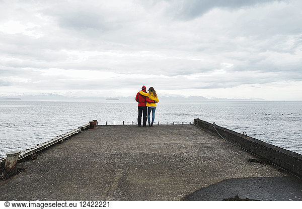 Iceland,  North of Iceland,  back view of couple standing on jetty looking at view, Iceland,  North of Iceland,  back view of couple standing on jetty looking at view