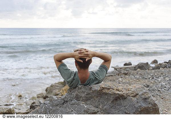 Indonesia,  Sumatra,  young man at ocean coastline, Indonesia,  Sumatra,  young man at ocean coastline