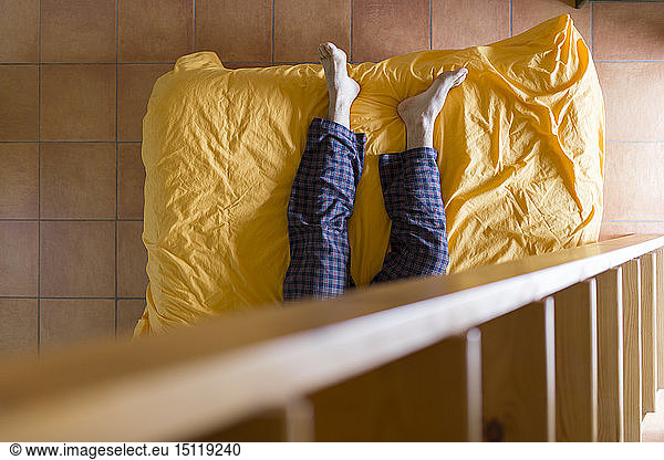 Man lying on bed,  wooden ladder
