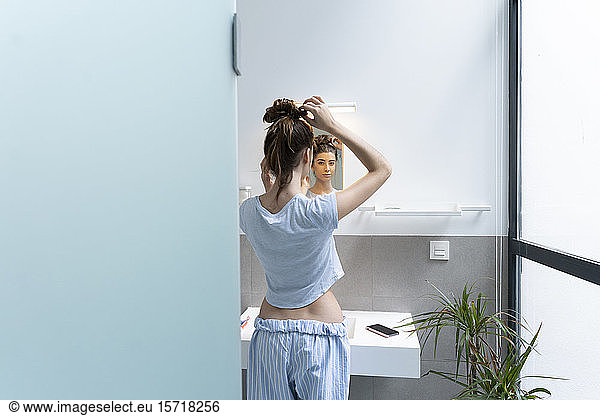 Rear view of young woman in bath room