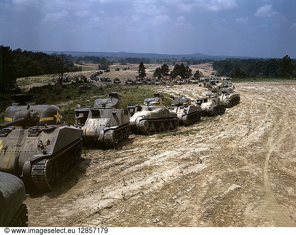 TANK MANEUVERS,  1942. Parade of M-4 'Sherman' and M-3 'Grant' tanks during training maneuvers at Fort Knox,  Kentucky. Photograph by Alfred T. Palmer,  June 1942.