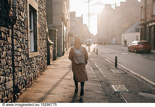 Woman walking on street,  Edinburgh,  Scotland