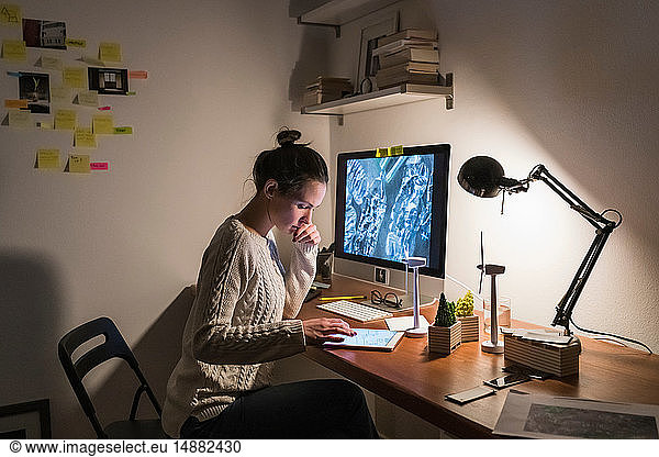 Woman working late at home