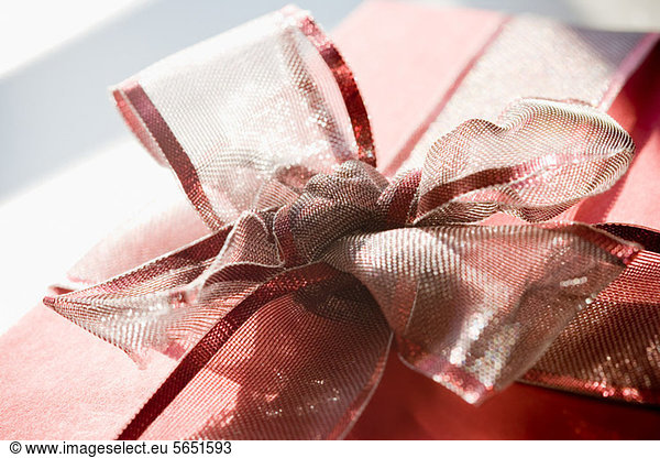 Red gift with ribbon bow
