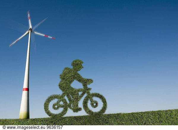 Eco friendly green bicycle in a windfarm