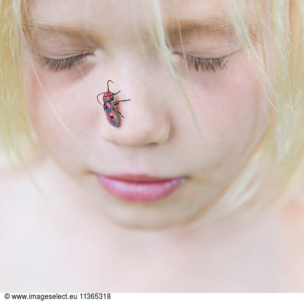 Boy with insect on nose