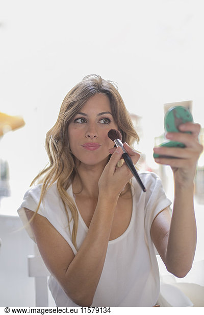 Woman with make-up in a Cafe