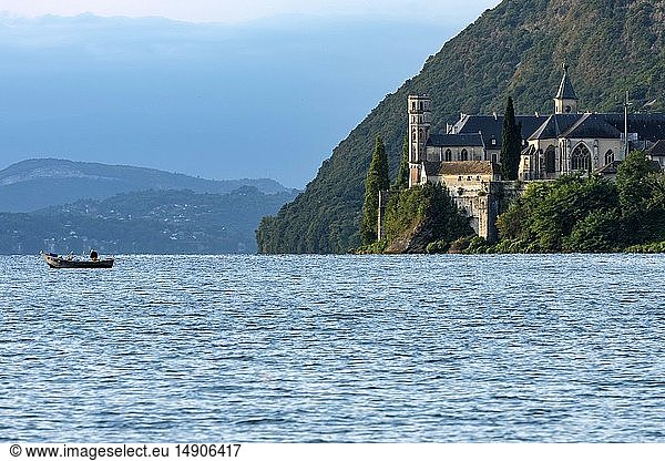 France,  Savoie,  Le Bourget du Lac,  Wild Coast,  Professional fisherman setting his nets next to the Royal Abbey of Hautecombe
